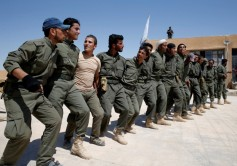 FILE PHOTO: Graduates of a U.S.-trained police force, which expects to be deployed in Raqqa, dance during a graduation ceremony near Ain Issa village, north of Raqqa, Syria, June 17, 2017. REUTERS/Goran Tomasevic/File Photo